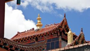 12- Details of the roof ornaments of one of the smaller shrine halls of the monastery - the Shabten Lhakhang