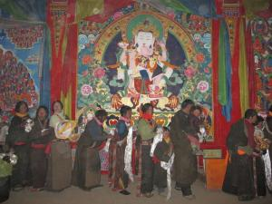 Pilgrims line up to meet body mandala, below fresco of Vajrasattva