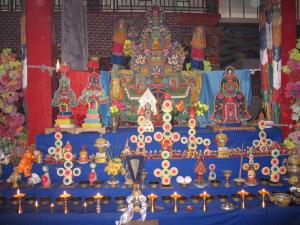 Butter sculptures and tormas on shrine of offerings to body mandala of HH Kusum Lingpa