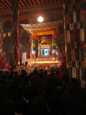 Pilgrims before body mandala of HH Kusum Lingpa at night